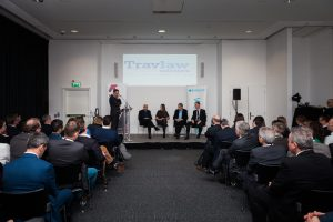 An audience and panel at the Big Tent Event